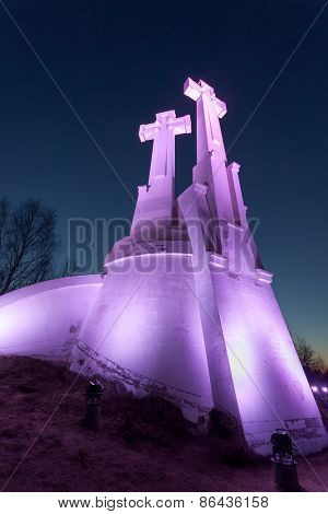 VILNIUS, LITHUANIA -March 19, 2015: Purple Illuminated Monument of Three Crosses on the Bleak Hill at the dawn time. It is one of main landmarks of Lithuania Capital city.