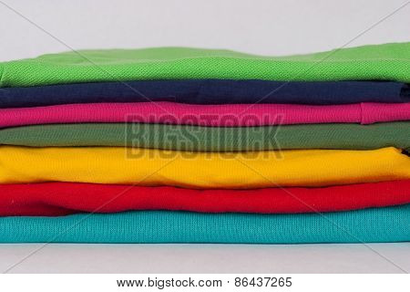 Stack Of Various Sweaters