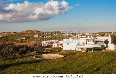 Green Field, Olive Trees Near The Village Houses And The Sky With Clouds. Mykonos, Greece.