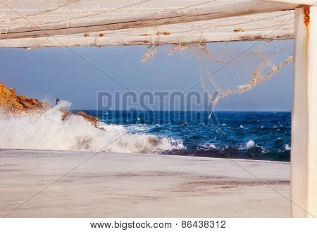 Waves Crashing On The Pier Of The Mykonos Island, Greece