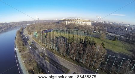 MOSCOW, RUSSIA - FEB 26, 2014: Football stadium Luzhniki against cityscape at sunny day. Aerial view