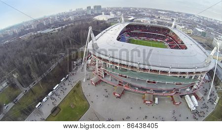 MOSCOW, RUSSIA - MAR 30, 2014: Cityscape with people walk away from Locomotive sports stadium at spring day. Aerial view