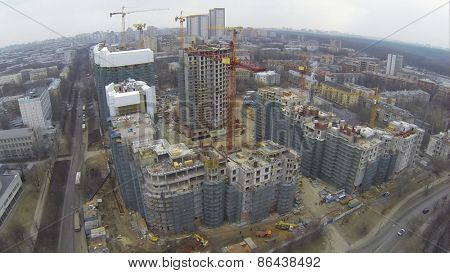 MOSCOW, RUSSIA - MAR 02, 2014: Aerial view of construction of new high buildings with green building grid at Vinogradnyi complex.