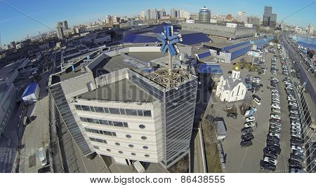 MOSCOW, RUSSIA - MAR 12, 2013: Cityscape with Expo Center exhibition complex at sunny day. Aerial view
