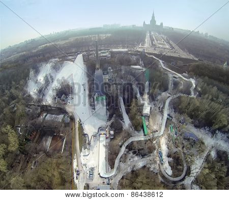 MOSCOW, RUSSIA - MAR 08, 2014: Ropeway on snow-covered slope among trees during Speed Descend on Skates competition by Red Bull at sunny day. Aerial view