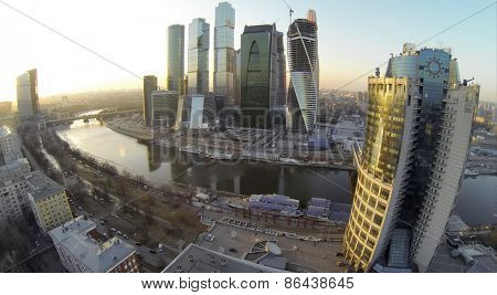 MOSCOW, RUSSIA - MAR 01, 2014: River quay with skyscraper complex Moscow City against cityscape at sunny day. Aerial view
