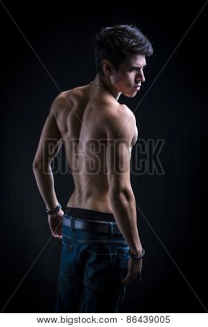 Handsome Muscular Shirtless Young Man From The Back
