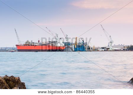 Cargo Ship Loading In Cargo Terminal