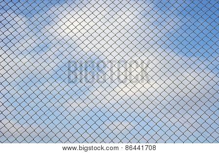 Fence Metallic Net And Cloudy Sky