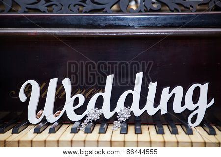The Word Wedding On The Piano