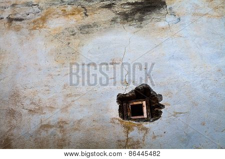 Small window in the old wall