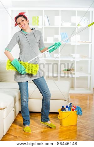 Funny woman mopping floor and playing.