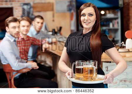 Waitress with a tray of beer