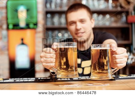 Barman with glasses of beer