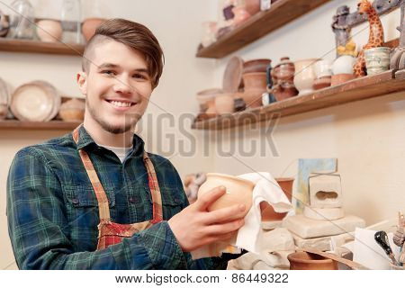 Man holds a clay pot