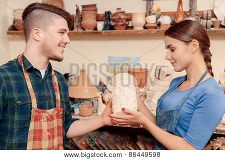Giving a vase to the potter