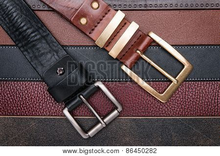 Close-up Of Two Men Belts