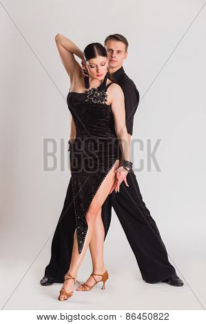 Man and woman dancing ballroom dances.