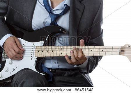 Man In Suit Playing Electric Guitar Isolated On White