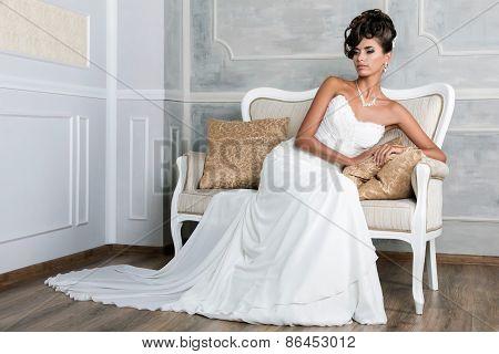 Portrait Of Young Luxurious Brunette Bride