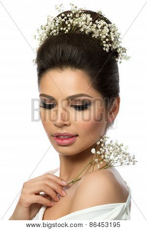 Portrait Of Young Beautiful Woman With Flowers In Her Hair