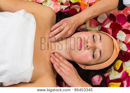 Beautician revitalizing facial.