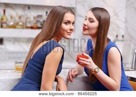 Women gossip in the bar