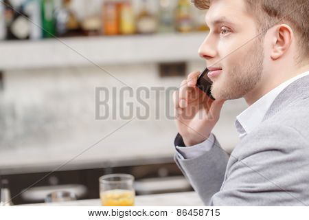 Young man talks over the phone
