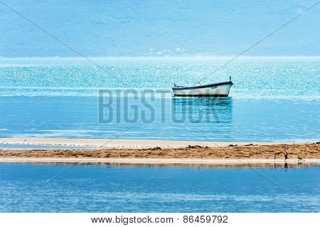 A Peaceful Scene From Croatian Coast On The Adriatic Sea With A Small Boat In Shallows