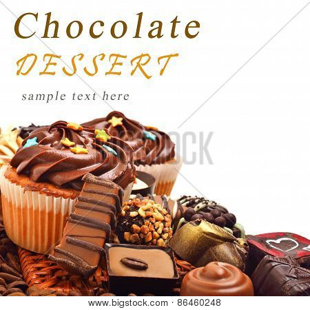 Chocolate Muffins With A Heap Of Chocolate Sweets, Candies Isolated
