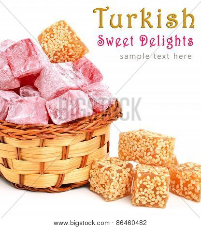 Turkish Sweet Delights In Icing Sugar In The Basket Isolated On White