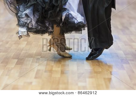 Closeup Of Legs Of The Professional Dance Couple Performing European Standard Program