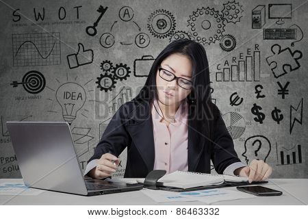 Busy Entrepreneur Working With Laptop And Planner