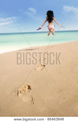 Footprints On Sand And Jumping Woman