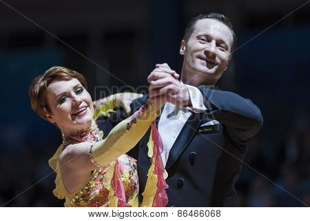 Minsk, Belarus-febriary 14, 2015: Senior Dance Couple Of Sergey Domorad And Svetlana Domorad Perform