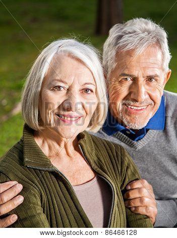 Portrait of happy senior couple at campsite