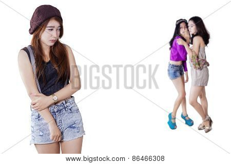 Sad Girl With Friends Gossiping On The Back