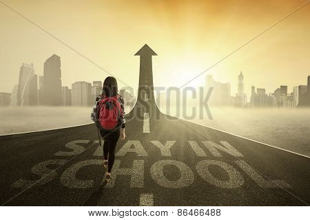 Schoolgirl On The Road To Stay In School