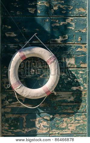 Life Buoy On The Old Wooden Paneled Background