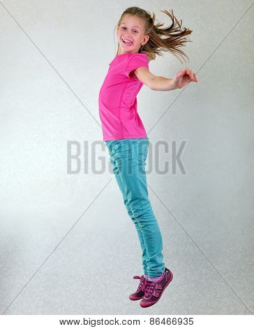 Cute Pretty Smiling Girl Jumping