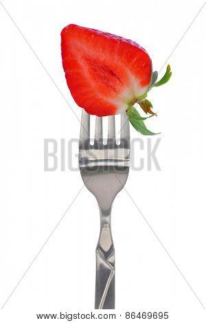 Fresh strawberry on fork, isolated on white