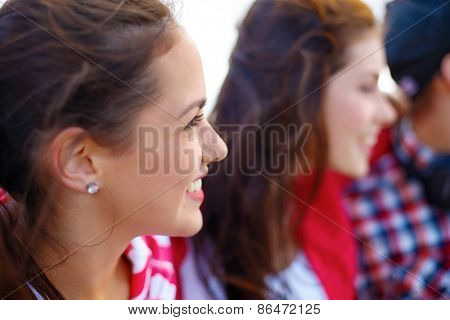 summer holidays, people and happiness concept - smiling teenage girl outdoors with friends