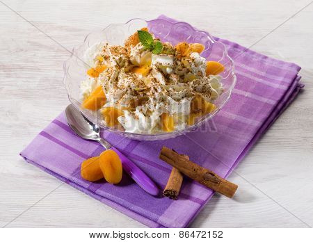 apricot dessert with sliced almond and cinnamon