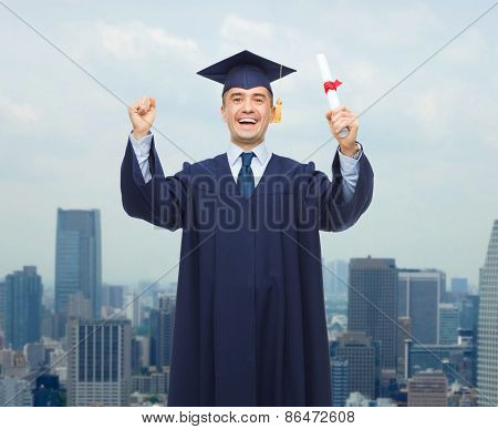 education, graduation and people concept - smiling adult student in mortarboard with diploma rising hands up and laughing over city background
