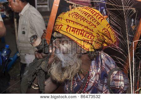 Sadhu Smokes A Pipe.