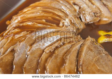 Sliced Roast Beef In Gravy At A Buffet