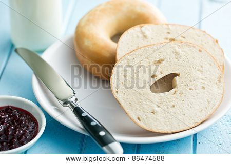 bagels on plate with knife