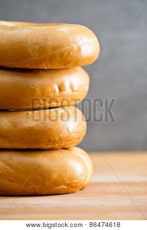 pile of bagels on kitchen table