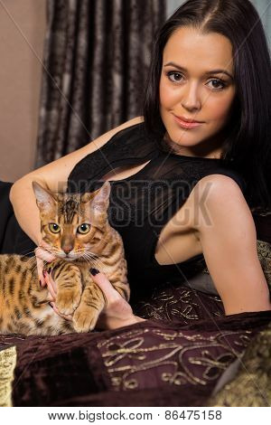 Brunette with bengal cat