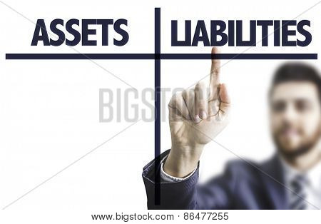 Business man pointing the text: Assets Liabilities
